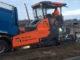 Attachment meijerink wegenbouw effent het pad met atlas copco dynapac sd2500cs 2 80x60